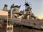 USS Iowa - side view from gangway with holiday lights at sunset.jpg
