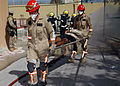 US Navy 040303-N-8955M-004 Emergency Response Team (ERT) personnel carry victims away from a simulated bomb explosion during Exercise Desert Sailor 2004 at Naval Support Activity Bahrain.jpg