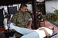 US Navy 040627-N-1464F-003 U.S. Naval Reserve Lt. Anthony Edwards checks the mobility of a local Peruvian woman during a medical evaluation.jpg