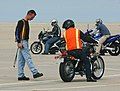 US Navy 040708-N-8970J-002 Motorcycle safety class instructor Chief Aviation Electronics Technician Dan Ganet shows a student where he should have stopped, during motorcycle driver training at Naval Auxiliary Landing Field (NAL.jpg