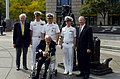 US Navy 040930-N-0295M-004 Cmdr. Michael Hegarty, center, stands with Former Secretary of the Navy Paul H. Nitze and friends after he was presented a Bronze Star at a ceremony held at the U.S. Navy Memorial in Washington, D.C.jpg