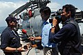 US Navy 041005-N-3503M-005 Vishnu Som and N. Ravi of New Delhi Television, interviews the Electrical Officer, Lt.j.g. Sam Barris, aboard the guided missile cruiser USS Cowpens (CG 63).jpg