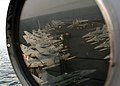 US Navy 041119-N-5345W-092 Aircraft await flight operations on the flight deck of Nimitz-class aircraft carrier USS Harry S. Truman (CVN 75) as they are viewed in the reflection of a signal light atop the ship's island.jpg