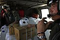 US Navy 050107-N-6074Y-066 Aviation Machinist's Mate Airman Gillies, right, speaks with the pilots of his MH-60S Knighthawk helicopter, while flying water and relief supplies to Banda Aceh on the island of Sumatra, Indonesia.jpg