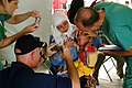 US Navy 050212-N-0357S-085 Cmdr. Kurt Hummeldorf of the U.S. Navy Dental Corps, takes photographs of an Indonesian child with a retinal tumor.jpg