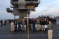 US Navy 050327-N-8604L-002 Sailors aboard the conventionally powered aircraft carrier USS Kitty Hawk (CV 63) attend Easter Sunrise Service on the flight deck aboard the ship.jpg