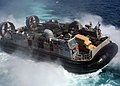 US Navy 050618-N-5313A-067 A Landing Craft, Air Cushion (LCAC), assigned to Assault Craft Unit Four (ACU-4), backs out of the well deck of the amphibious assault ship USS Kearsarge (LHD 3).jpg