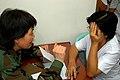 US Navy 060530-N-2832L-050 Navy Lt. Cmdr. Doris Wong, an optometrist, distributes eye glasses at Zamboanga Health Center.jpg