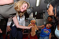 US Navy 070709-N-8704K-018 Mrs. Laura Stavridis, wife of Commander, U.S. Southern Command, Adm. James Stavridis, gives a stuffed animal donated by Hugs Across America to a young child aboard the Military Sealift Command hospita.jpg