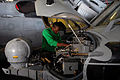 US Navy 070728-N-7981E-414 Aviation Electronics Technician 3rd Class Carlos Lee, assigned to the Golden Falcons of Helicopter Anti-submarine Squadron (HS) 2 performs maintenance on the avionics system of an SH-60F Seahawk.jpg