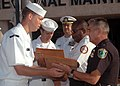 US Navy 070911-N-1522S-007 Chief petty officer selectees assigned to Southeast Regional Maintenance Center present plaques, recognizing Naval Station Mayport's police and fire departments, to Major Werner Schrenk, right, and Fi.jpg