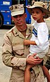 US Navy 080724-N-1688B-060 Chief Steelworker Mike Welch, assigned to Amphibious Construction Battalion (ACB) 2, carries his son to the car.jpg