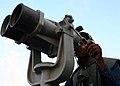 US Navy 080923-N-6764G-015 Seaman Brandon Lewis scans the horizon while transiting the Suez Canal.jpg