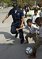 US Navy 090220-N-1251W-008 Fire Controlman 2nd Class Travius Caldwell plays soccer with students from the Ban Klong Sai School.jpg