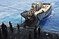 US Navy 090711-N-9740S-454 A landing craft utility (LCU), attached to Assault Craft Unit (ACU) 2, prepares to unload mail and supplies into the well-deck of the of the multi-purpose amphibious assault ship USS Bataan (LHD 5).jpg