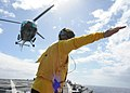 US Navy 090803-N-6138K-530 Landing signalman enlisted Boatswain's Mate Seaman Dustin Cochran guides a Mauritius National Coast Guard Alouette Class III helicopter during flight operations aboard the guided-missile destroyer USS.jpg