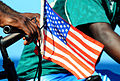 US Navy 100123-N-7508R-051 A Haitian citizen flies an American flag on his bicycle as a display of appreciation to U.S. service members supporting Operation Unified Response.jpg