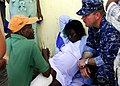 US Navy 100127-N-5244H-055 Senior Chief Hospital Corpsman Bryant iscusses treatment of a pregnant Haitian woman during an emergency response in Bonel, Haiti.jpg