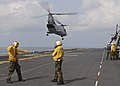 US Navy 100201-N-9950J-360 Aviation Boatswain's Mate (Handling) Airman Daniel Tesauro, left, from New Jersey, and Aviation Boatwain's Mate (Handling) 3rd Class Lois Braxton, from New York, direct the lift off of a CH-46E Sea Kn.jpg