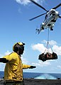 US Navy 100207-N-5538K-251 Aviation Boatswain's Mate Airman Tione M. Williams directs an SA-330J Puma helicopter.jpg