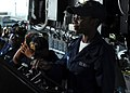 US Navy 100215-N-1688B-004 Seaman Apprentice Nateisha Fairley mans the helm aboard USS Hue City (CG 66).jpg