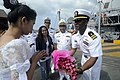 US Navy 100215-N-8335D-235 A Cambodian woman presents flowers to Lt. Cmdr. Walter Mainor.jpg