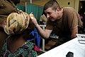 US Navy 100317-N-7948C-013 Hospital Corpsman 3rd Class Matthew Colemaw gives a Ghanaian woman an eye examination.jpg