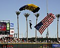 US Navy 100327-N-2389S-115 A member of the elite U.S. Navy Leap Frogs parachute team glides into the Goodyear Ballpark, before an exhibition Diamondback vs. Indians national baseball league game in Phoenix, Ariz.jpg
