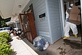 US Navy 100506-N-5319A-014 Volunteers help Ship's Serviceman 1st Class Scott Overstreet and his wife remove their belongings after severe flooding damaged many of their personal items in a family housing area of Naval Support A.jpg