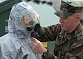 US Navy 100608-N-9520G-007 Master-at-Arms Seaman Peter Biloschaetzke, right, from Rancho Culamonga, Calif., checks the face mask seal on Master-at-Arms 2nd Class Lindsey Podd, from Allendale, N.J.jpg