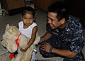 US Navy 100608-N-9643W-889 Lt. Michael Quisao hands a stuffed dog to a patient at Alacaldia Municipal De Corinto.jpg