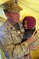 US Navy 101114-M-1880C-172 Chief Petty Officer Robert Davis, assigned to 2nd Battalion, 6th Marine Regiment, holds an infant that was brought to th.jpg