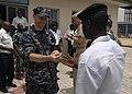 US Navy 110408-N-HI707-201 Capt. Shawn Duane presents Nigerian navy Ordinary Seaman Mohammed Nafiu with an Africa Partnership Station lapel pin aft.jpg