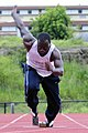 US Navy 111004-N-KT462-097 Aviation Maintenance Administrationman 3rd Class Jackie Wilson trains for the Armed Forces Track and Field team while de.jpg