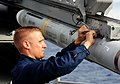 US Navy 111117-N-FH966-583 A Sailor installs wire on a Sea Sparrow missile.jpg