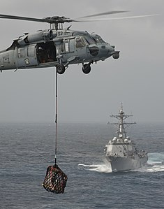 US Navy 120102-N-DR144-140 A helicopter delivers pallets during a vert replenishment at sea.jpg