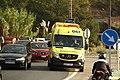 Una ambulancia en la carretera Porriño-Gondomar a su paso por Vincios, en una de las zonas incendiadas (37010530044).jpg
