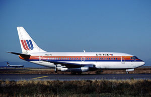 Boeing 737 - An early-production, retrofitted United Airlines 737-200 with deployed thrust reversers.