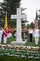 United States Military Order of the Cootie lay wreaths at the Argonne Cross in Arlington National Cemetery (30577615491).jpg