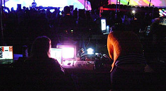 VJing - Two VJs collaborating on a mix at an outdoor electronic music festival.