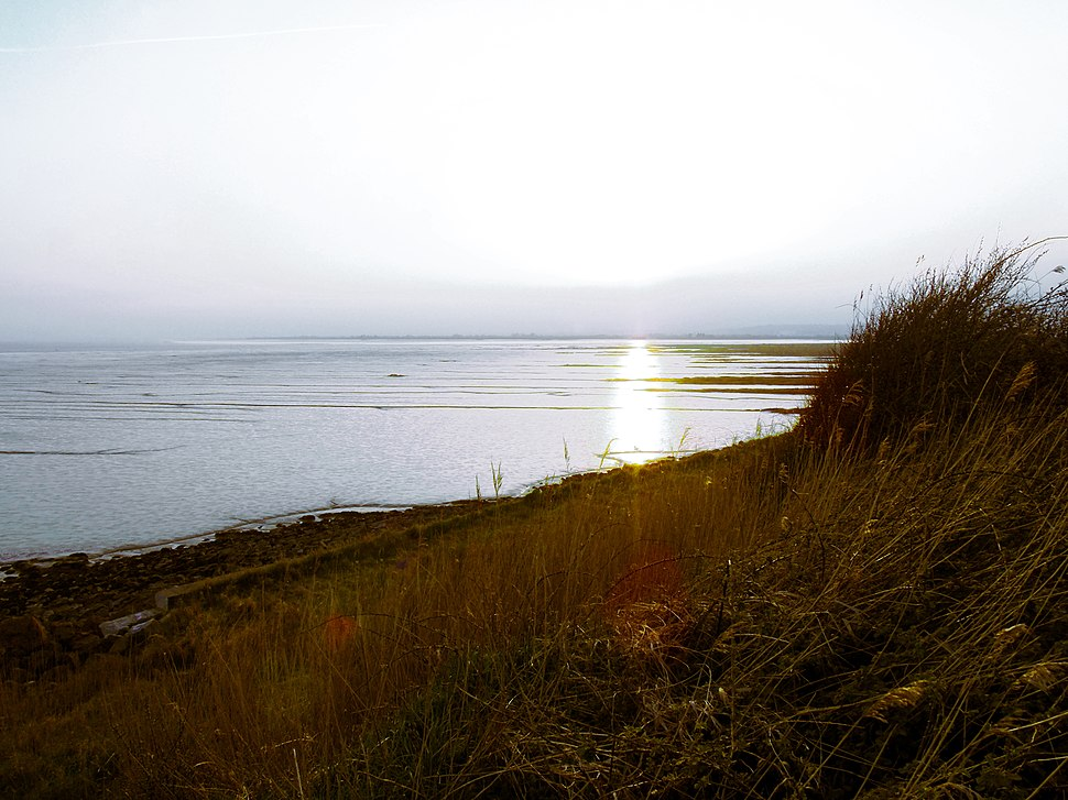 View of Sun Setting Over Severn Estuary From Newport Wetlands RSPB Reserve