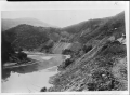 View of the mouth of the Duck Point railway tunnel, above the Taieri River ATLIB 334904.png