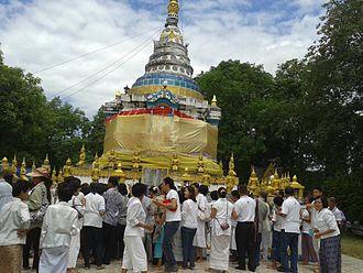Phan District - Local people gathering at Wat Phra Thart Chom Chaeng to make merit