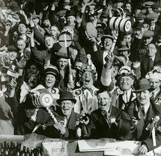 West Ham fans display their rosettes, scarves and novelty hammers at an FA Cup match in 1933 WestHamFans.jpg