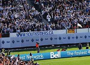 Vancouver Whitecaps FC - Whitecaps supporters celebrating 4–2 victory over Toronto FC at Empire Field during inaugural MLS match.