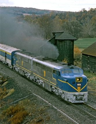 ALCO PA - Two former Santa Fe PA1s haul railfan passengers on the Delaware & Hudson in October 1974.