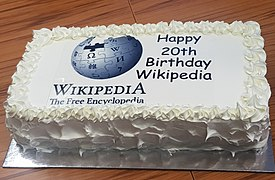 Wikipedia 20th Birthday Cake3 at Wikipedia Conference Hokitika 2021 (cropped).jpg