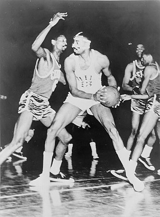 NBA Finals - Bill Russell (off ball) was a member of one of the first dynasties in the NBA, winning eight straight titles while contending against Wilt Chamberlain (on ball).