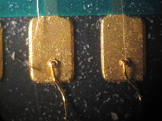 Wire bonding - Gold wire ball-bonded to a gold contact pad