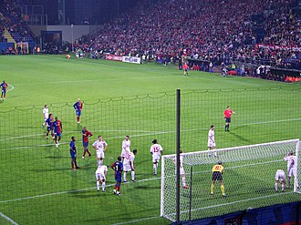 2009 UEFA Champions League Final - Barcelona's players prepare to attack a corner in the second leg of their third qualifying round tie against Wisła Kraków.